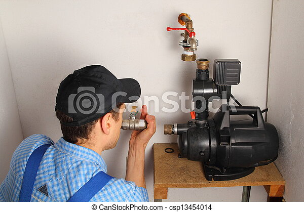 Man installing a water pump - csp13454014