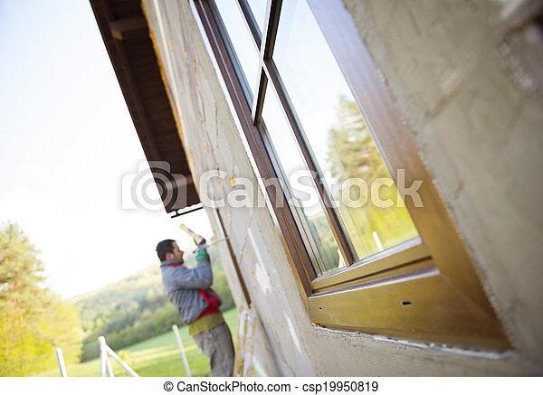 Man insulating windows - csp19950819