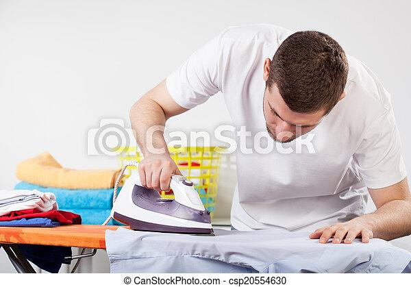 Man ironing clothes - csp20554630