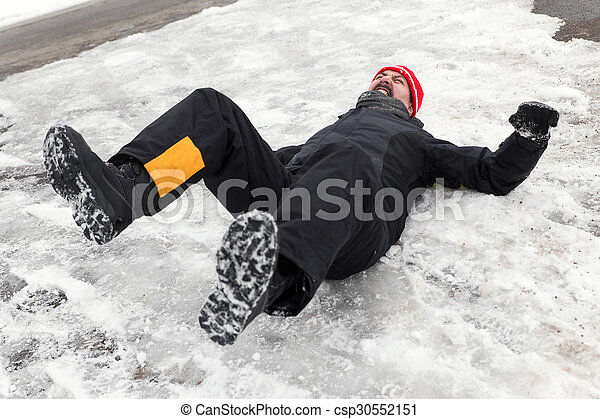 Man is lying on a icy way - csp30552151