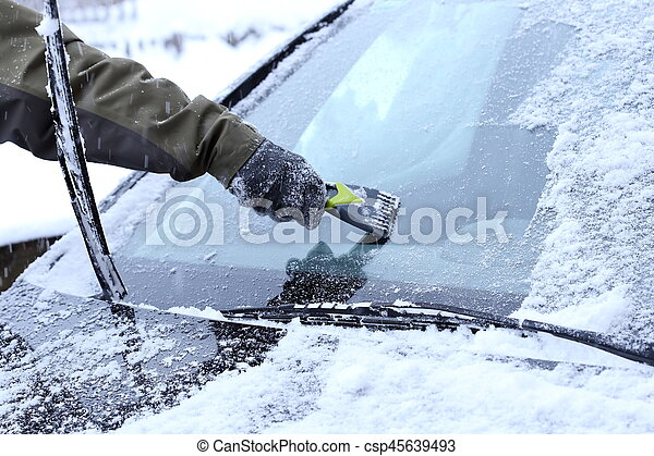 man is scraping a wind screen - csp45639493