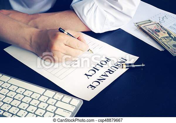 Man is signing up an insurance policy. - csp48879667