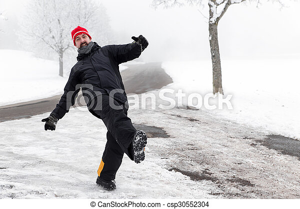 Man is slipping on a icy road - csp30552304