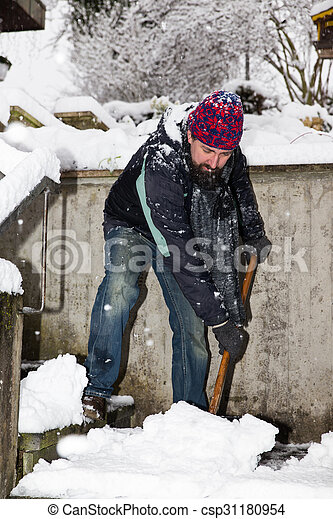 man is snow shoveling the stairs - csp31180954