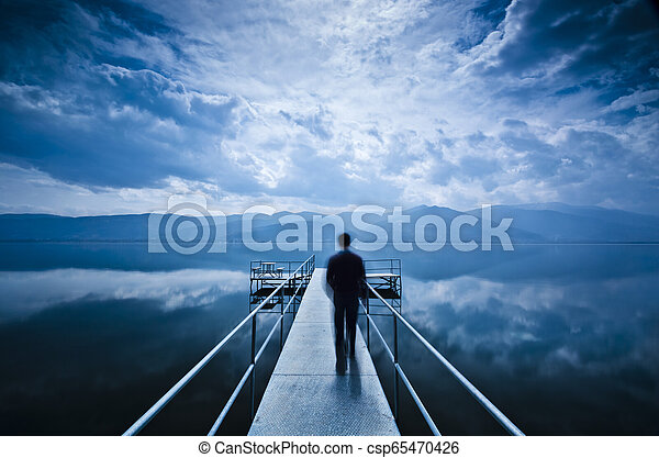 Man is Walking on the Pier - csp65470426