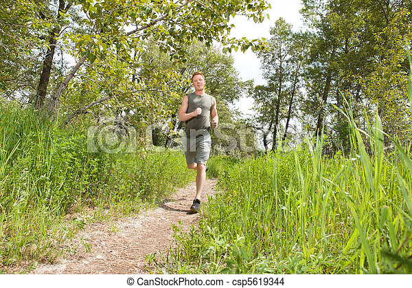 Man jogging in forest - csp5619344