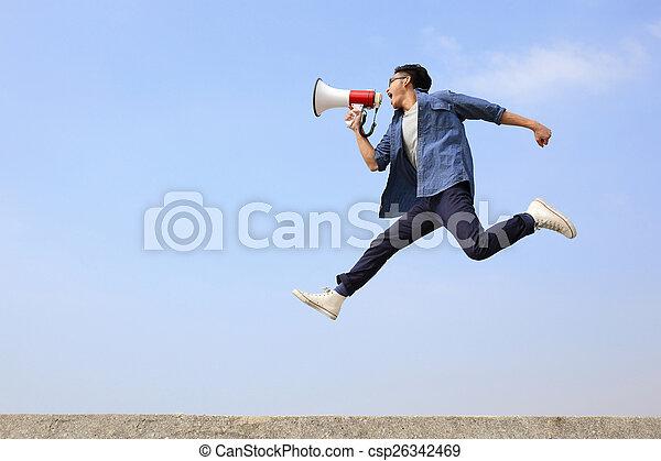 man jump and shout megaphone - csp26342469