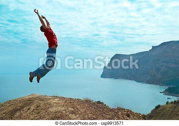 Man jumping cliff - csp9913571