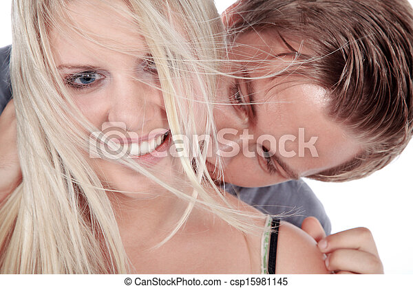 man kissing woman in the neck - csp15981145