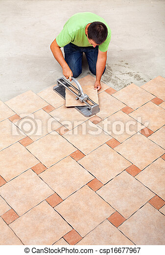 Man Laying Ceramic Floor Tiles Top View With Copy Space