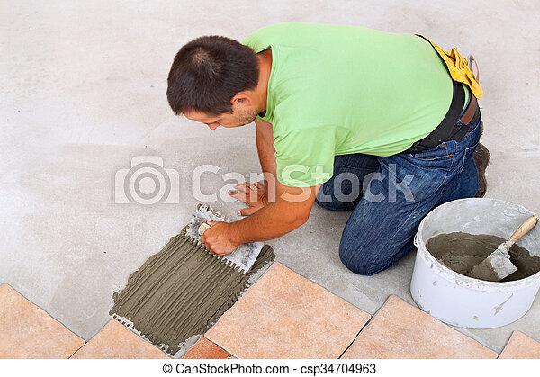 Man Laying Ceramic Tiles Floor Spreading The Adhesive Man Laying