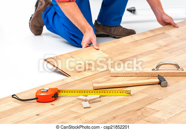 Man Laying Laminate Flooring Carpenter Worker Installing Laminate