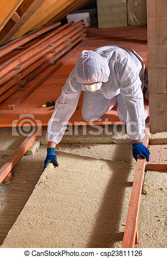 Man laying thermal insulation layer - wearing protective clothin - csp23811126