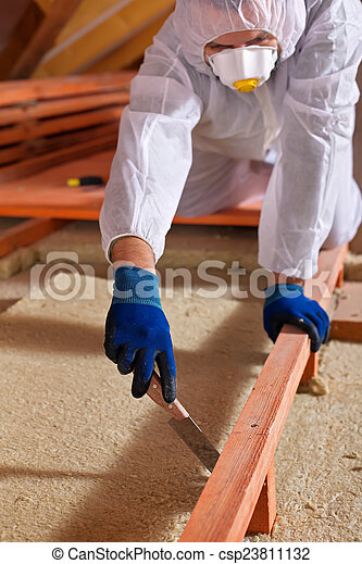 Man laying thermal insulation layer on building - csp23811132
