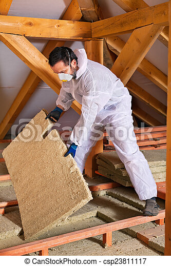 Man laying thermal insulation layer - csp23811117