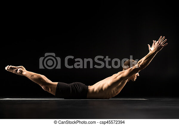 Man lying in yoga position - csp45572394