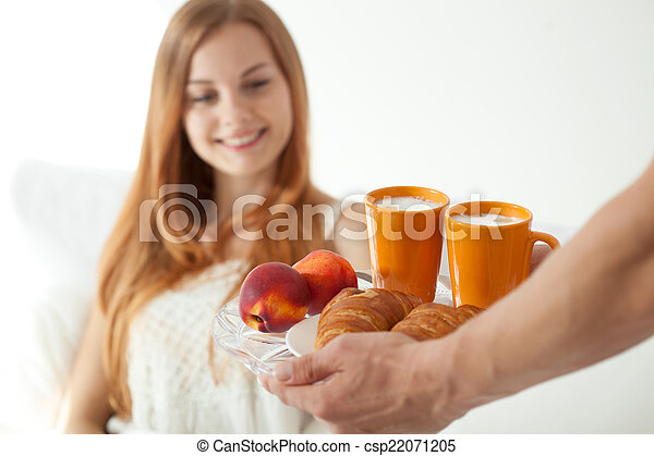 Man made breakfast for woman - csp22071205