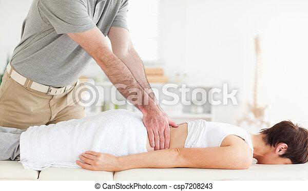 Man massaging a cute woman's back - csp7208243
