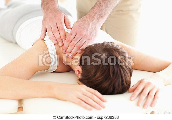 Man massaging a woman's neck - csp7208358
