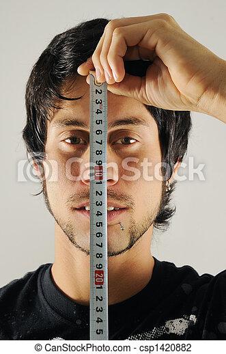 Man measuring his face - csp1420882