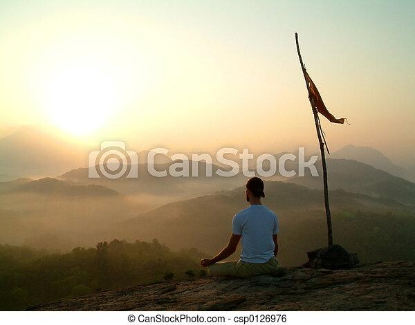 man meditating at su - csp0126976