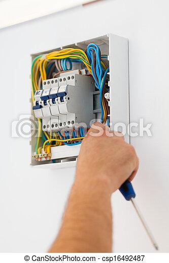 Man Mounting Electric Fuse - csp16492487