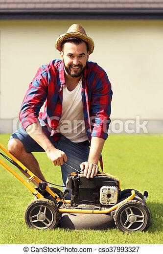 Man mowing the grass - csp37993327