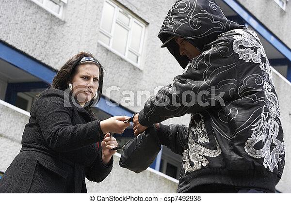 Man Mugging Woman In Street - csp7492938