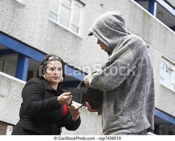 Man Mugging Woman In Street - csp7436019