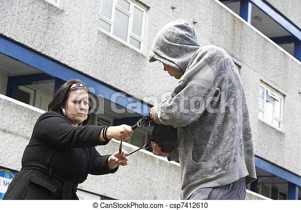 Man Mugging Woman In Street - csp7412610