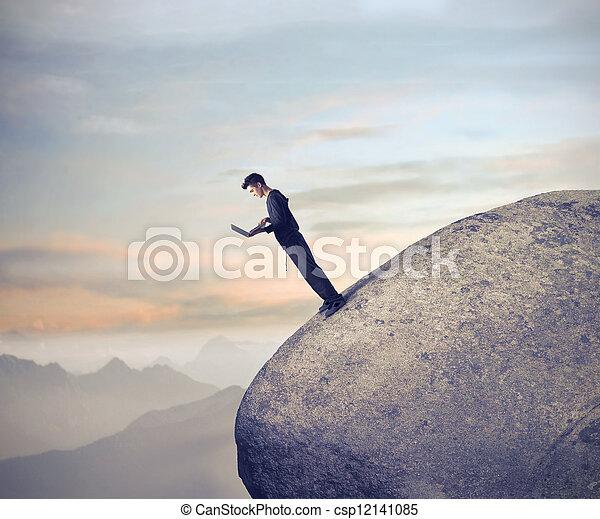 Man on huge stione - csp12141085