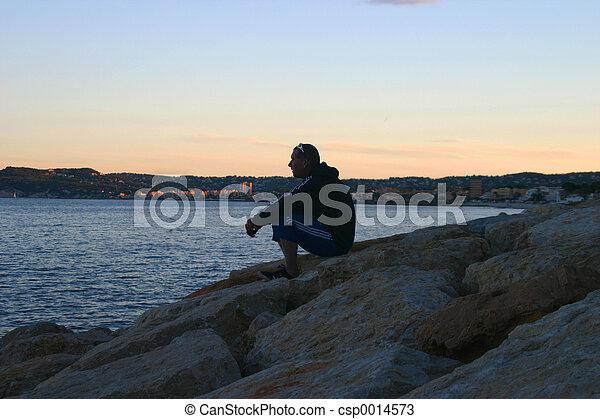 man on rocks - csp0014573