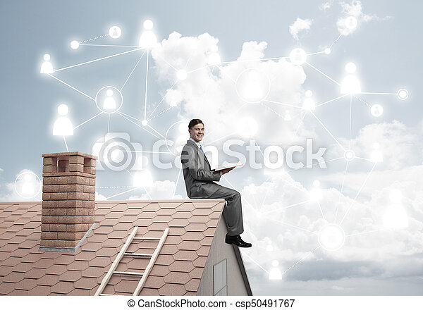 Man on roof reading book and concept of social connection - csp50491767