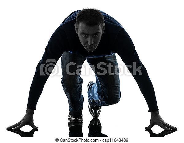 man on starting blocks silhouette full length - csp11643489