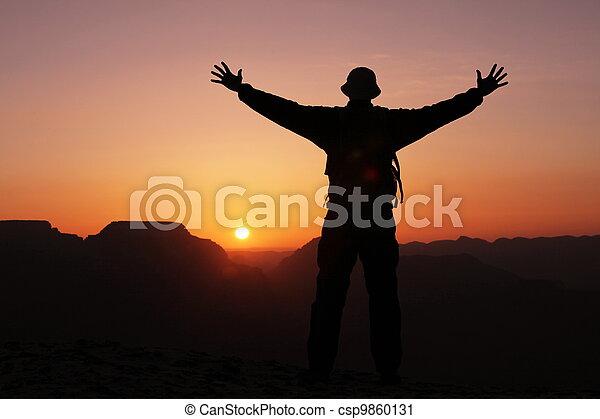 Man on sunset - csp9860131
