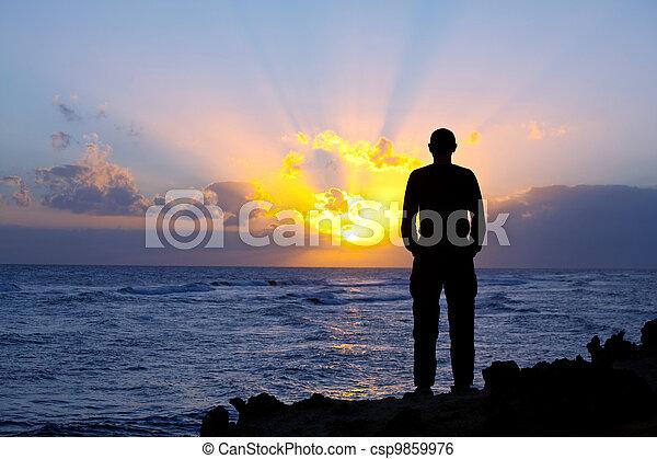 Man on sunset - csp9859976