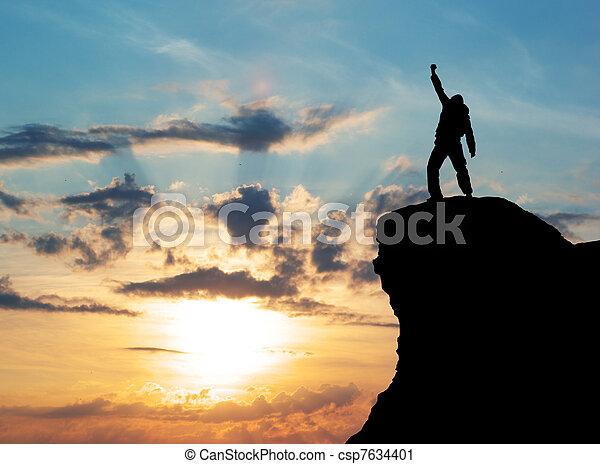 Man on top of mountain - csp7634401