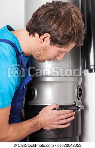 Man opening central vacuum cleaner - csp20042053