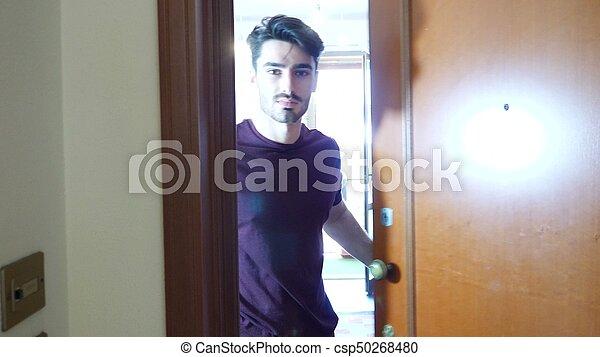 Man opening door and inviting - csp50268480