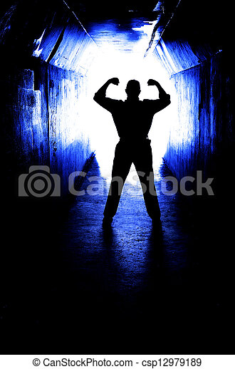 Man Overcoming Fear and Accomplishing Goal - csp12979189