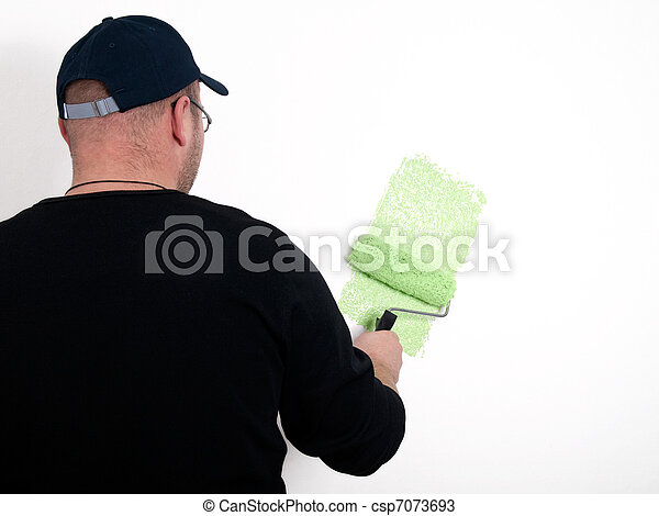 man painter a wall with paint roller  - csp7073693