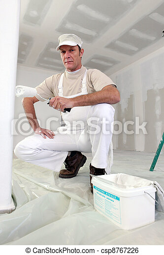 Man painting a room white - csp8767226