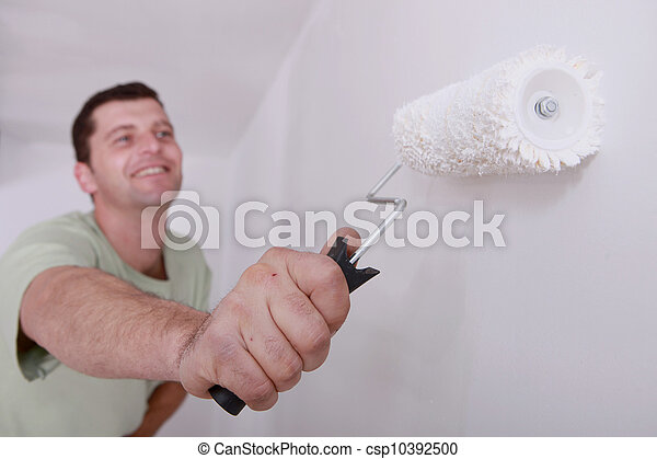 Man painting a room white - csp10392500