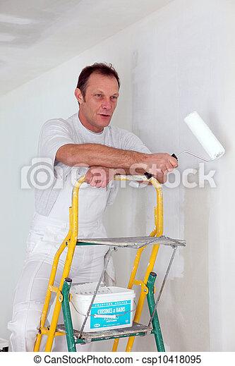 Man painting a wall - csp10418095