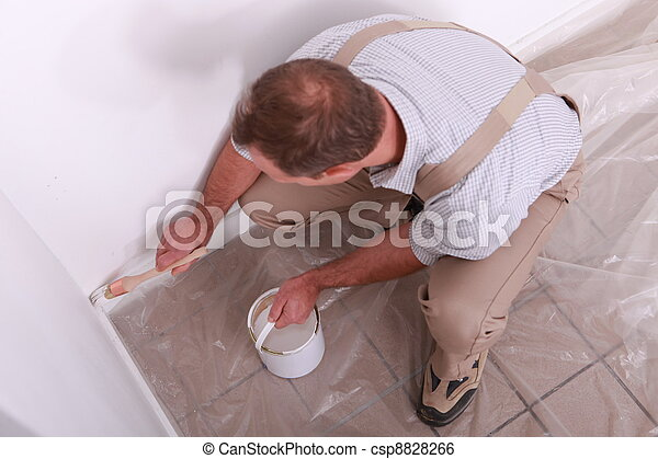 Man painting a wall white - csp8828266