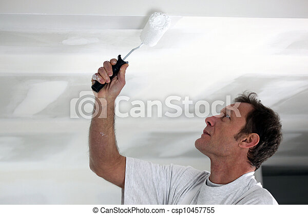 Man painting his ceiling white - csp10457755