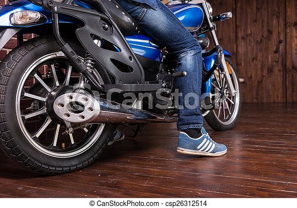 Man parking his motorbike - csp26312514