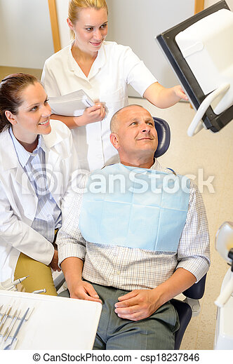Man patient at dental consultation dentist surgery - csp18237846