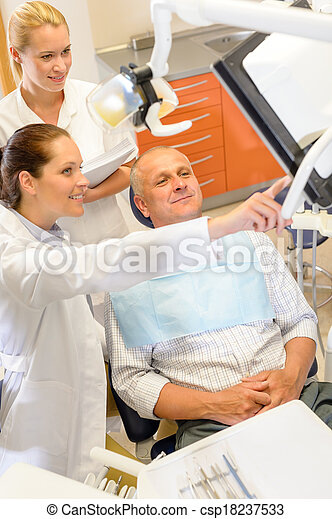 Man patient at dental consultation dentist surgery - csp18237533