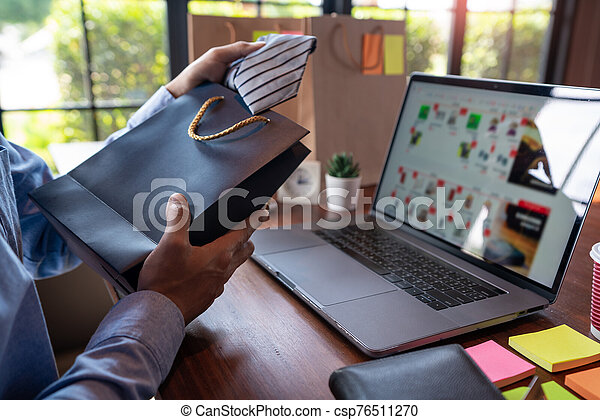 Man paying with credit card and entering security code for online shopping making a payment or purchasing goods on the internet with laptop computer, online shopping concept - csp76511270